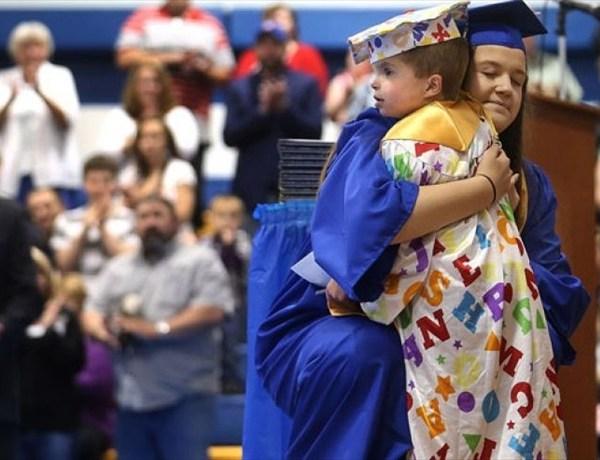 Child graduates_-7993115447932663190