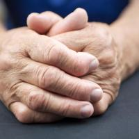 rheumatoid-arthritis-in-senior-persons-clasped-hands_1551823518152.jpg
