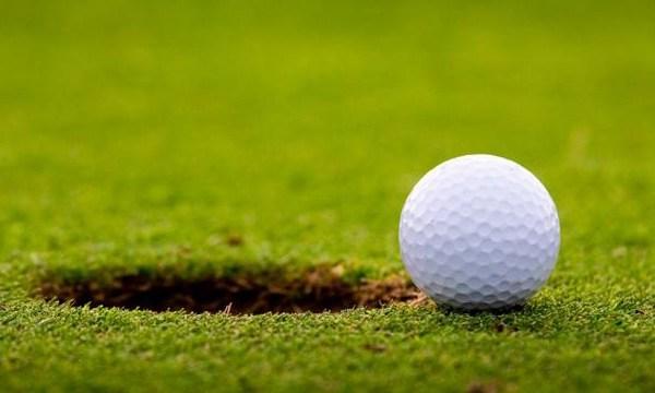 Golf ball on edge of hole_2143169203034654-159532