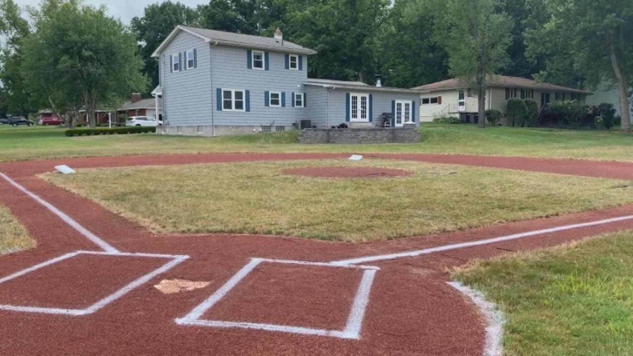 Field of dreams: Dad builds backyard baseball diamond