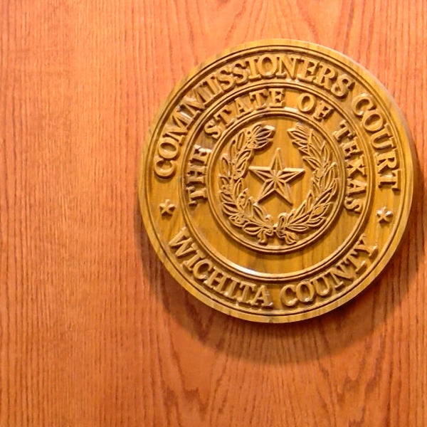 After a day-long and sometimes heated hearing in open session on Monday, Wichita County Commissioners voted not to fire an embattled human resources director amid controversy questioning whether or not she fabricated an email which is considered a government document.