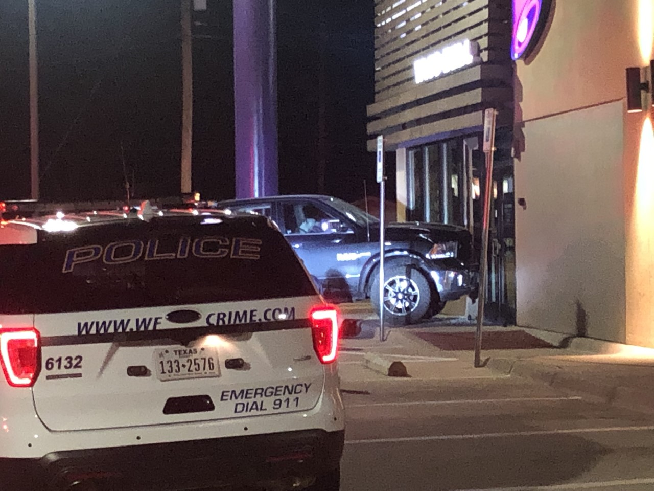 Man arrested after reportedly crashing into local Taco Bell restaurant