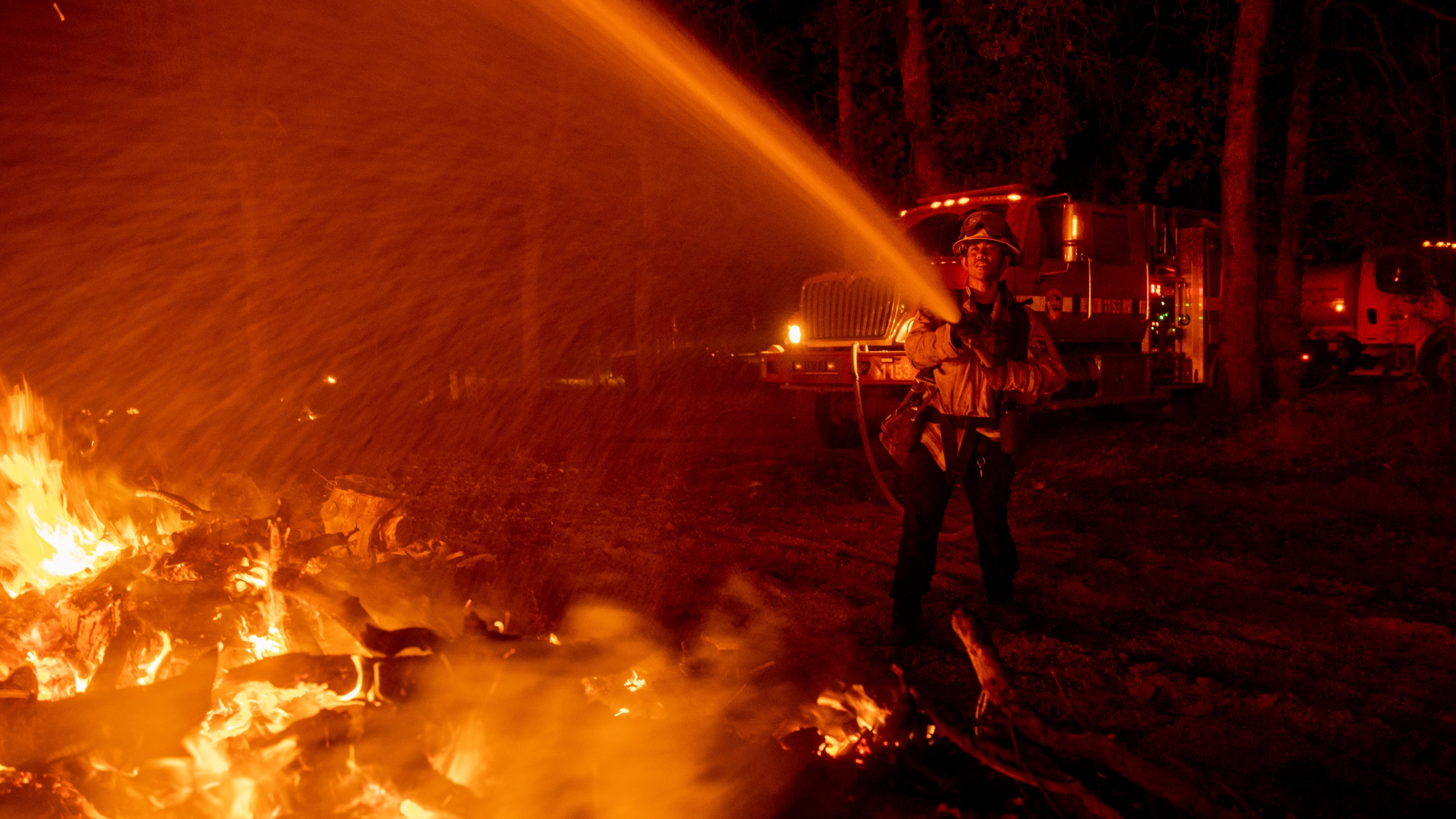 Firefighter Ron Burias battles the Fawn Fire as it spreads